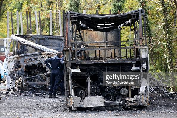 Police forensics officers prepare to remove the wreckage of a bus and a lorry which were involved in a head on collision on October 26 2015 in...