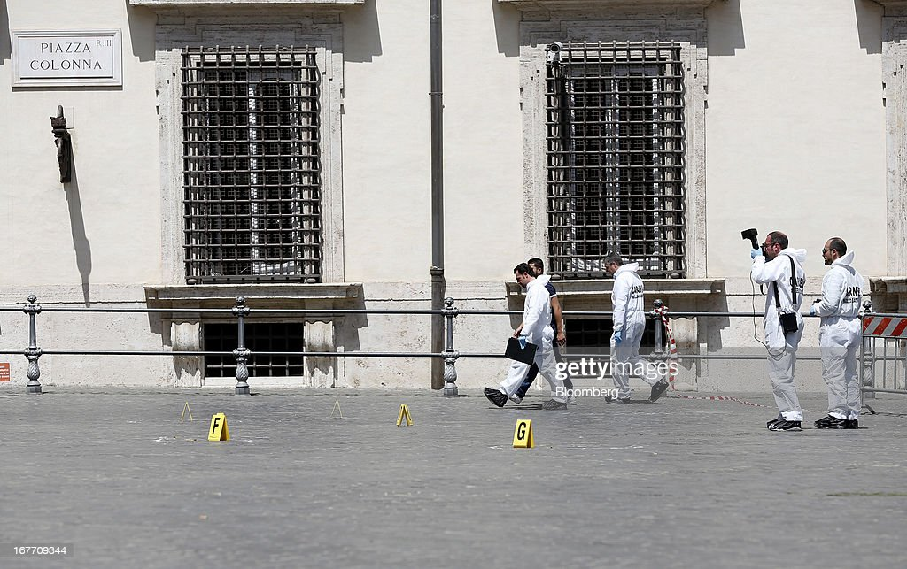 Police forensics officers work outside the Chigi Palace following a shooting in Rome, Italy, on Sunday, April 28, 2013. Two Italian police officers were shot outside the prime minister's office in Rome today by a lone gunman while the country's new premier, Enrico Letta, was being sworn in across town, police said. Photographer: Alessia Pierdomenico/Bloomberg via Getty Images