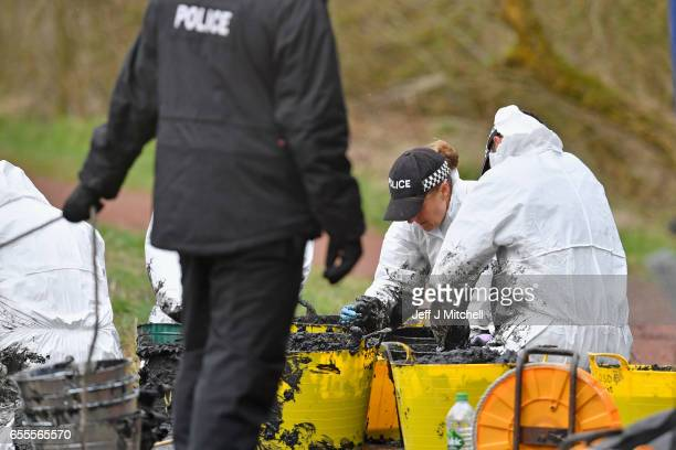 Police forensics search through material gatherd by Police Scotland divers searching a canal stretch for an eleven year old schoolgirl Moira Anderson...