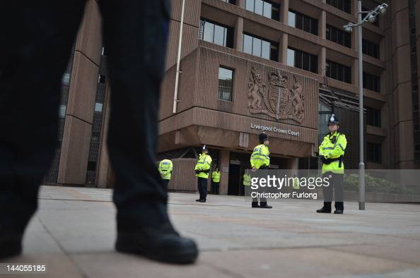 Police form a cordon outside Liverpool Magistrates Court for the sentencing of nine men found guilty of child exploitation on May 9 2012 in Rochdale...