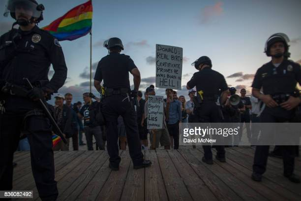 Police form a line to keep demonstrators and counter demonstrators apart at an 'America First' demonstration on August 20 2017 in Laguna Beach...
