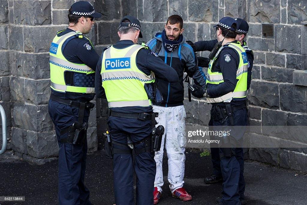 Police frisks a True Blue Crew member during a protest organized by the anti-Islam True Blue Crew supported by the United Patriots Front in Melbourne, Australia on June 26, 2016.