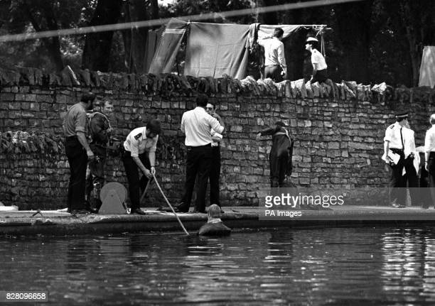 Police frogmen searching the River Thames while other officers search the towpath today for clues to the identity of the young girl whose naked body...