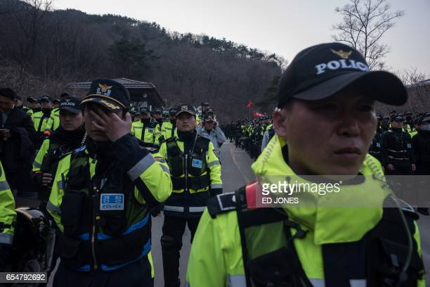 Police gather as residents of Seongju county participate in a protest against the recently installed US Terminal High Altitude Area Defense system...