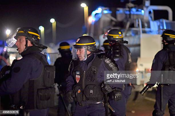 Police gather at the entrance to camp known as the 'New Jungle' where they used water canon and tear gas on December 4 2015 in Calais France...