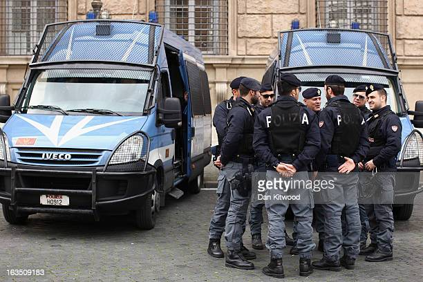 Police gather near to the entrance to Vatican City on March 11 2013 in Rome Italy Cardinals are set to enter the conclave to elect a successor to...
