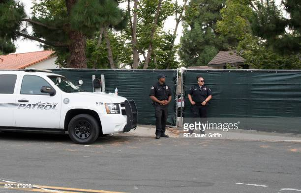 Police gather outside the house of Linkin Park's lead singer Chester Bennington after the frontman's reported suicide on July 20 2017 in Palos Verdes...