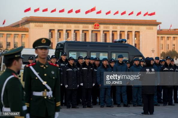 Police gather outside the opening session of the Chinese Communist Party's fiveyearly Congress at the Great Hall of the People in Beijing on November...
