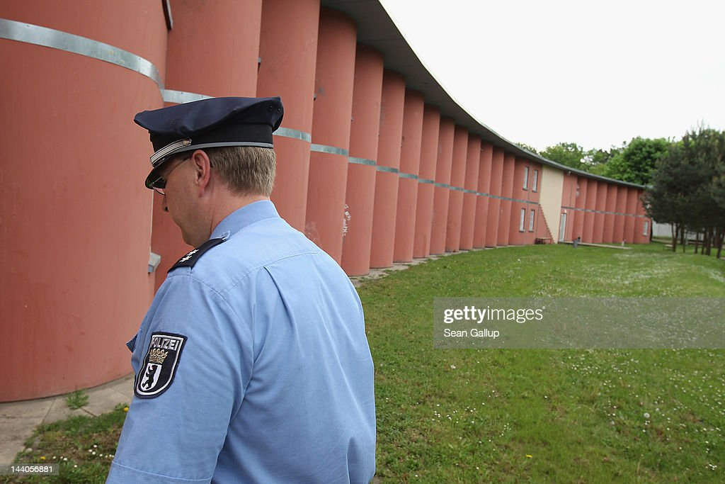 A police gaurd walks toward a cell block at the expanded youth arrest facility in Lichtenrade district on May 9, 2012 in Berlin, Germany. The facility, whose capacity is now nearly doubled, accomodates young men and women first-time offenders for short periods of time with the intent of giving them an impression of what prison is like yet to also give them a second chance at returning to freedom.