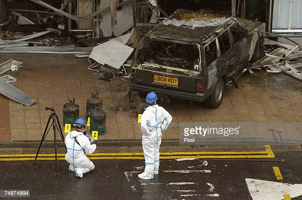 Police go over the scene at Glasgow Airport after a blazing car was driven into the airport's main terminal July 1 2007 in Glasgow Scotland...