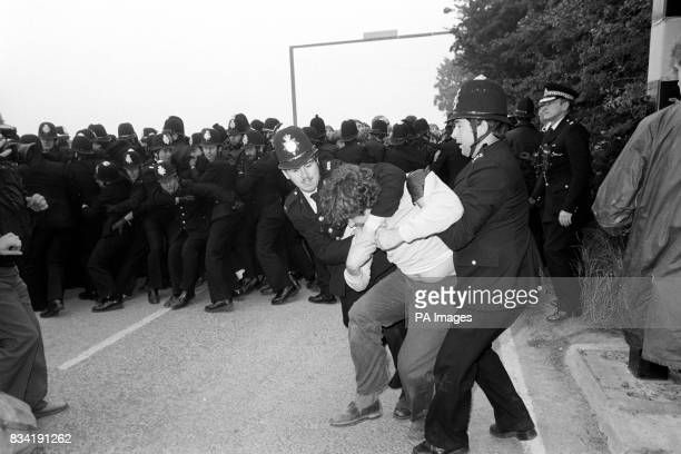 Police grapple with a picket as police lines other pickets back at Gascoigne Wood drift mine near Selby today