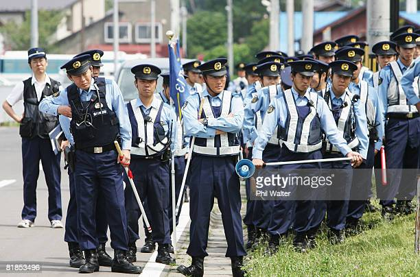 Police group up to contain the antiG8 activists as they prepare to march near the G8 Summit site on July 8 2008 in Date Hokkaido Japan The G8...