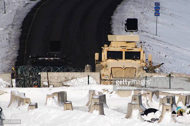 Police guard a bridge near Oceti Sakowin Camp on the edge of the Standing Rock Sioux Reservation on December 3 2016 outside Cannon Ball North Dakota...