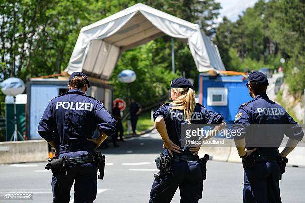 Police guard a checkpoint on a road leading to the the InteralpenHotel Tirol venue of the Bilderberg conference on June 11 2015 near Telfs Austria...