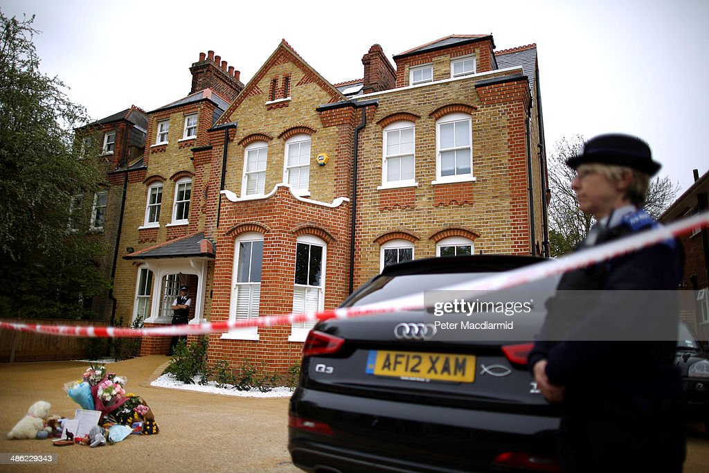 Police guard a house in New Malden where the bodies of three children were found on April 23, 2014 in south London, England. Police say that a 42-year-old woman has been arrested after the bodies of three children were found at a property last night.