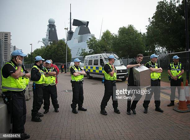 Police guard a road leading to HMS Duncan that is moored in Queen Alexandra Dock ahead of the Nato Summit 2014 on September 3 2014 in Cardiff Wales...