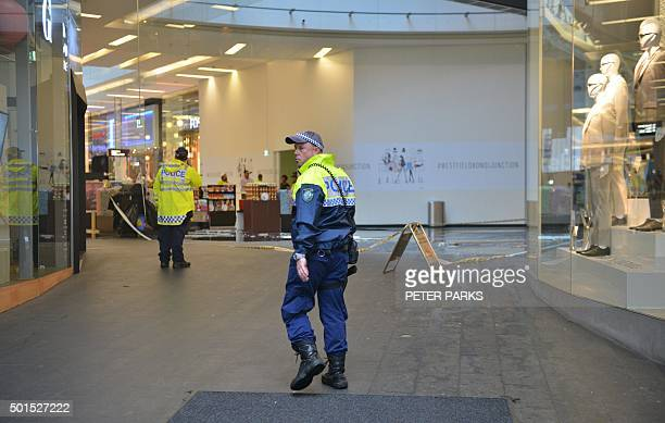 Police guard a shopping centre in Bondi Junction after part of the roof caved in during a storm in Sydney on December 16 2015 Sydney was smashed by a...