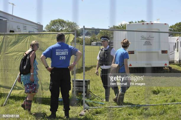 Police guard a side entrance to the VIP winnebago area of the hospitality area at Glastonbury festival where a body has been discovered in a portable...