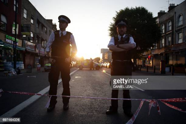Police guard a street in the Finsbury Park area of north London after a vehichle hit pedestrians on June 19 2017 One man was killed and eight people...