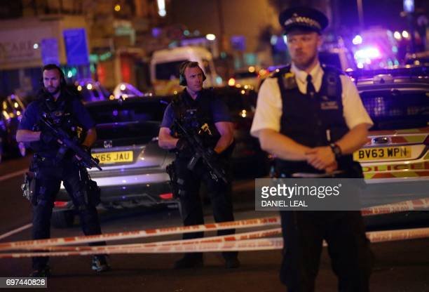 TOPSHOT Police guard a street in the Finsbury Park area of north London where a vehichle hit pedestrians on June 19 2017 One person has been arrested...