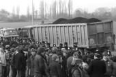 Police guard a truck full of coal from pickets during the miners' strike on March 20 1984
