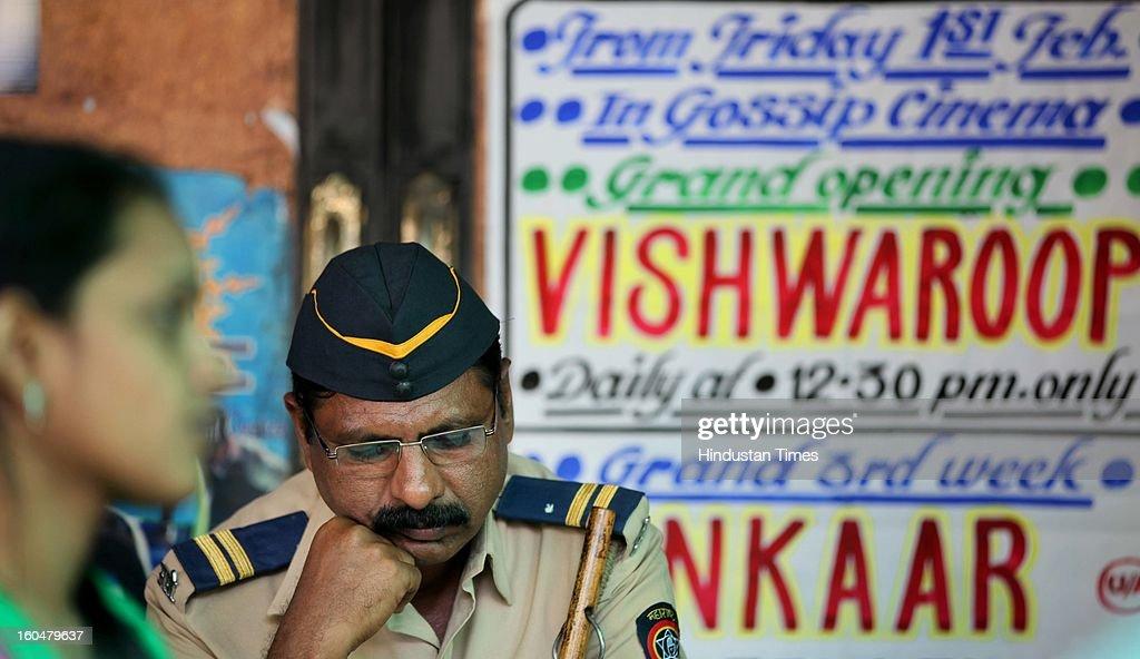 Police guard outside a Bandra Theatre where Kamal Haasan's film 'Vishwaroopam' was released at Dadar on February 1 2013 in Mumbai India...