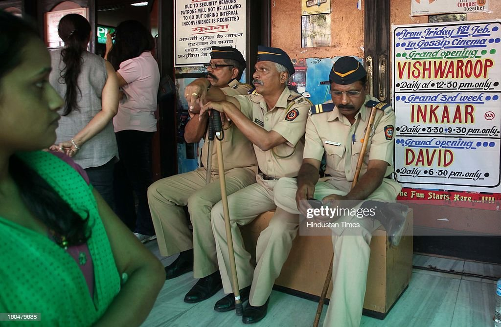 Police guard outside a Bandra Theatre where Kamal Haasan's film 'Vishwaroopam' was released at Dadar on February 1, 2013 in Mumbai, India. 'Vishwaroopam' released all over India amid security except Tamil Nadu where it was banned after some Muslim groups taken objection to certain scenes in the movie as hurting their religious sentiments.