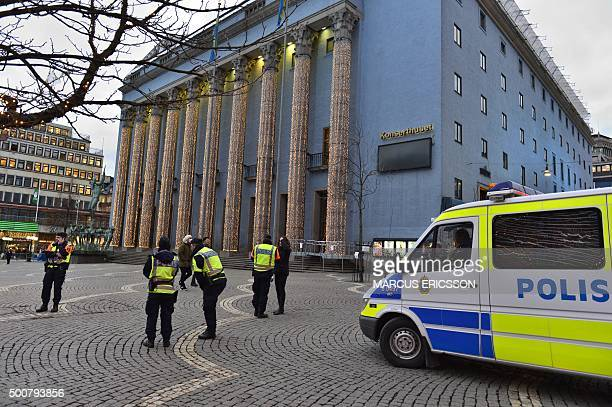 Police guard the cleared Haymarket Square usually bustling with market stalls in front of Stockholm Concert Hall prior to the 2015 Nobel prize award...