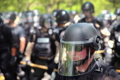 Police guard the entrance of McDonald's corporate campus as about 2000 fast food workers and activists demonstrating for higher wages march toward...