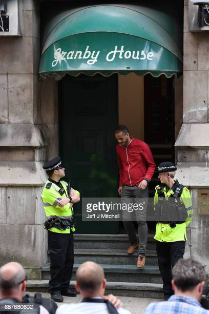 Police guard the entrance to Granby House in the city centre following an armed raid on May 24 2017 in Manchester England An explosion occurred at...