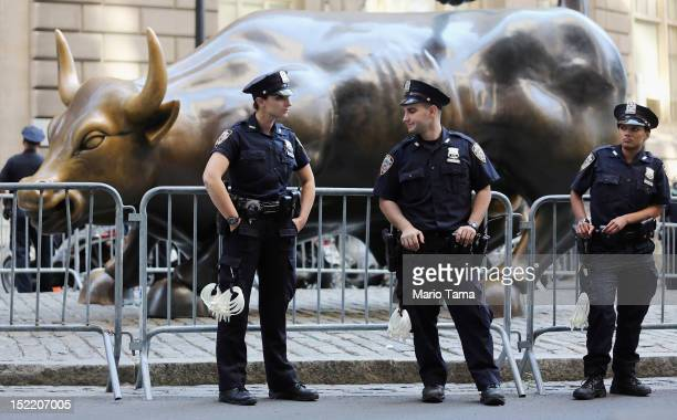 Police guard the famous bull statue during Occupy Wall Street protests in the Financial District on September 17 2012 in New York City Today is the...