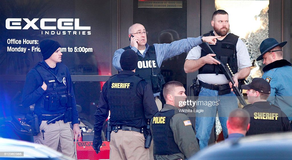 Police guard the front door of Excel Industries in Hesston Kan where a gunman reportedly killed up to seven people and injured many others on...