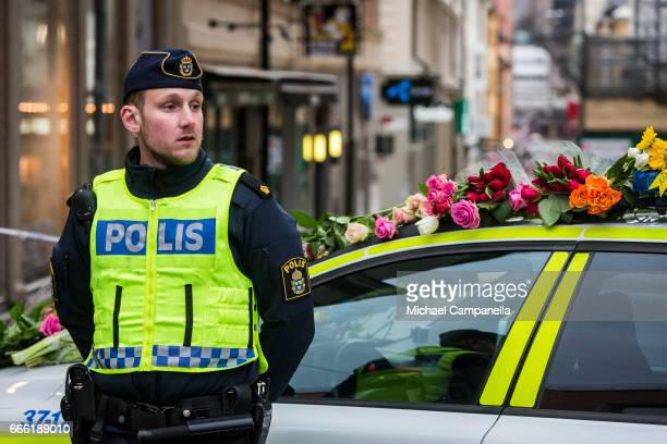 Police guard the scene at the site of the terrorist truck attack in downtown of the city where sympathy flowers are being left on April 8 2017 in...