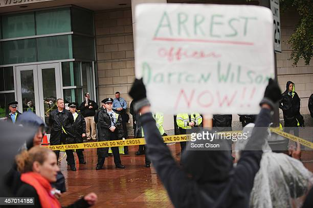 Police guard the St Louis county courthouse as protestors call for St Louis County Prosecuting Attorney Robert McCulloch to withdraw from the...