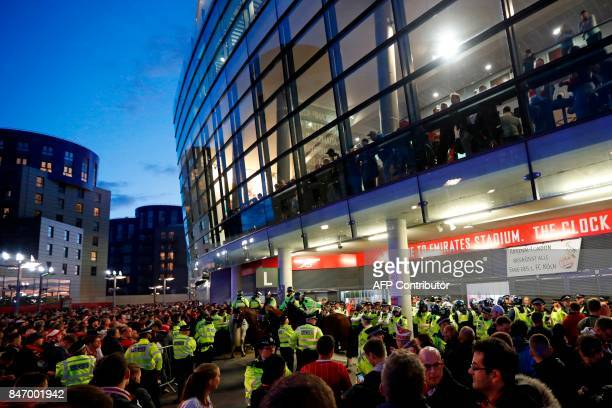 Police guard the stadium entrances as the kick off is delayed due to crowd safety issues ahead of the UEFA Europa League Group H football match...