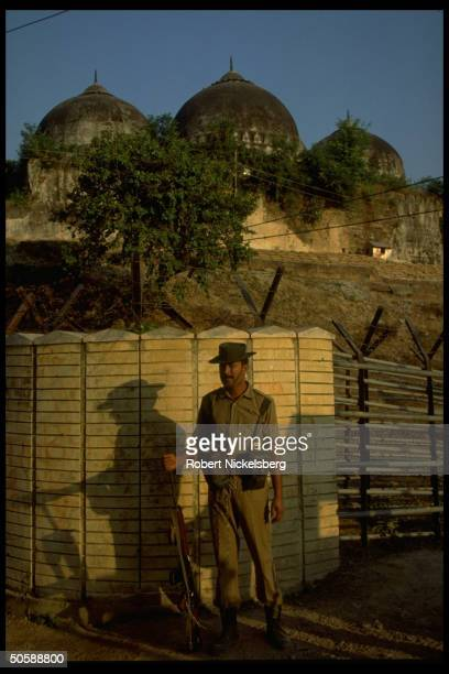 Police guarding fortified post by Babri Masjid against rioting Hindus bent on razing mosque erecting Hindu temple to godking Rama