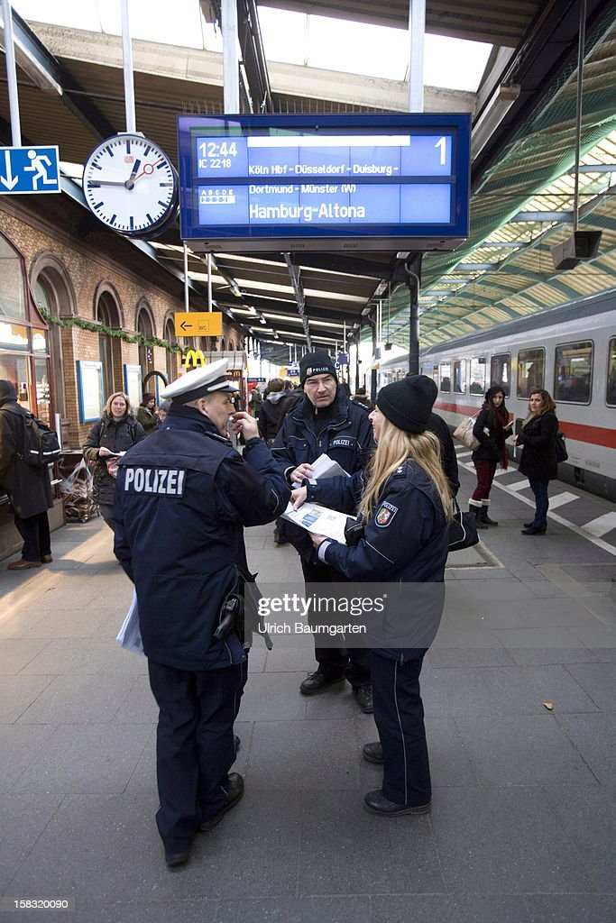 Police hand out a poster which shows the suspect of an attempted bomb attack at Bonn central train station on December 13, 2012 in Bonn, Germany. German police have begun searching for a second suspect they believe was behind a bomb scare in the western city of Bonn. The local police had expanded their search after spotting a potential suspect on video footage from a nearby fastfood restaurant.