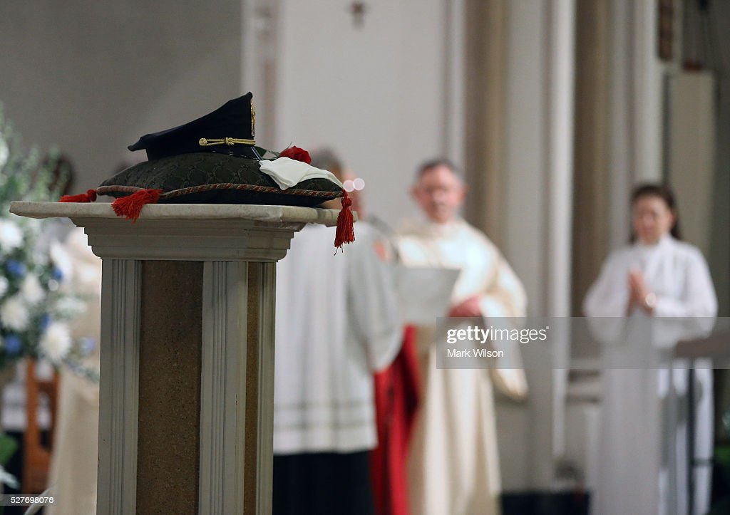 A police hat is placed on the alter during the 22nd annual 'Blue Mass' at St. Patrick's Catholic Church May 3, 2016 in Washington, DC. The mass is held by the National Law Enforcement Officers Memorial Fund to recognize the first responders who have given their lives in the past year.
