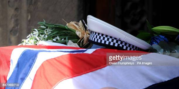 A police hat on top of the coffin of Pc David Rathband as it arrives at St Nicholas Cathedral Newcastle for a service to celebrate his life