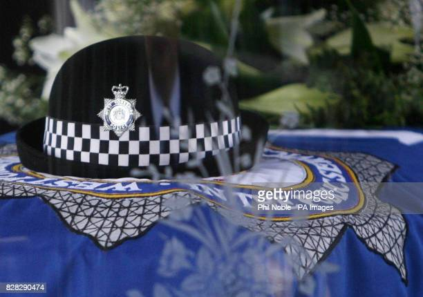 A police hat sits on top of the coffin of murdered police officer Sharon Beshenivsky which travelled through Bradford city centre in a horsedrawn...