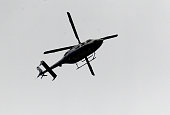 A police helicopter flies over the area near to the scene of a bomb attack which targeted a police bus in the Vezneciler district on June 7 2016 in...