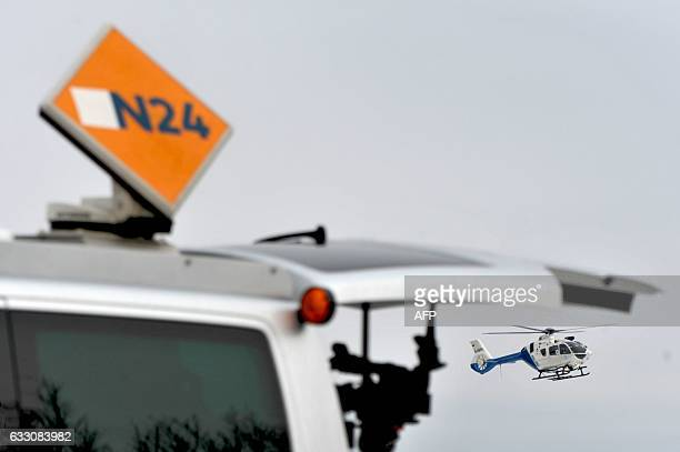 A Police helicopter flies over the private property where six teenagers were found dead in Arnstein central Germany on January 30 2017 Six teenagers...