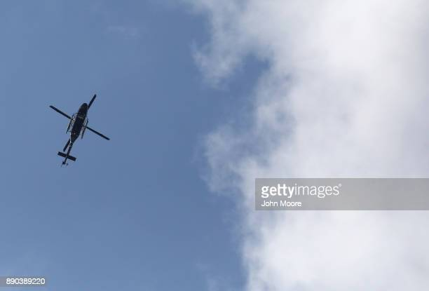 A police helicopter flies over the site of a pipe bomb explosion on December 11 2017 in New York City Police said that Akayed Ullah a Bangladeshi...