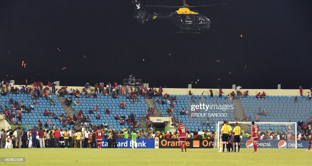 A police helicopter flies over the stadium during an interruption of the 2015 African Cup of Nations semifinal football match between Equatorial...