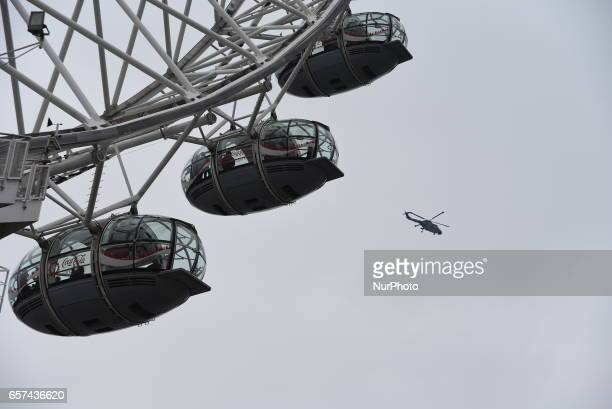A police helicopter hovers near the London Eye on March 24 2017 in London England A fourth person has died after Khalid Masood drove a car into...