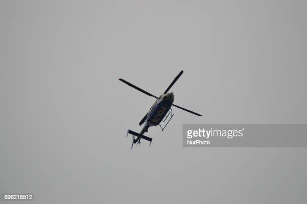 A police helicopter is seen during the 'Justice March' to protest against the Turkish government held by the main opposition Republican People's...