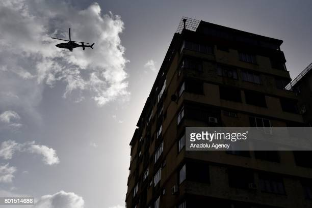 A police helicopter is seen flying during a protest demanding Venezulan President Nicolas Maduro's resignation and new elections in Caracas on June...