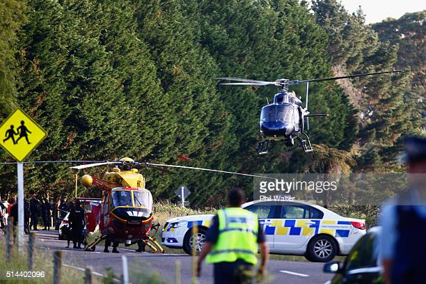 A police helicopter lands on a property near Kawerau on March 9 2016 in Rotorua New Zealand Four police officers were shot and injured earlier today...