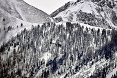 A police helicopter passes mountains as it comes in to land on March 25 2015 near Seyne France Germanwings flight 4U9525 from Barcelona to...