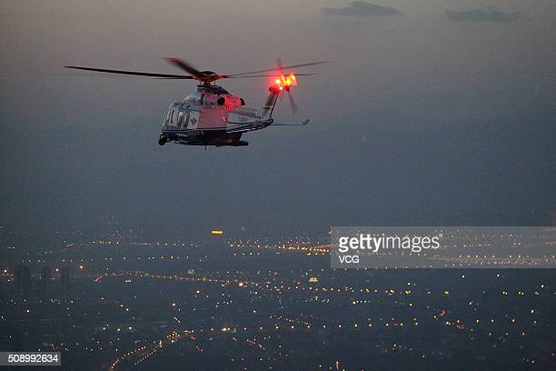 A police helicopter patrol in air to guarantee a safe Spring Festival on Festival on February 7 2016 in Beijing China 23 police helicopters have been...